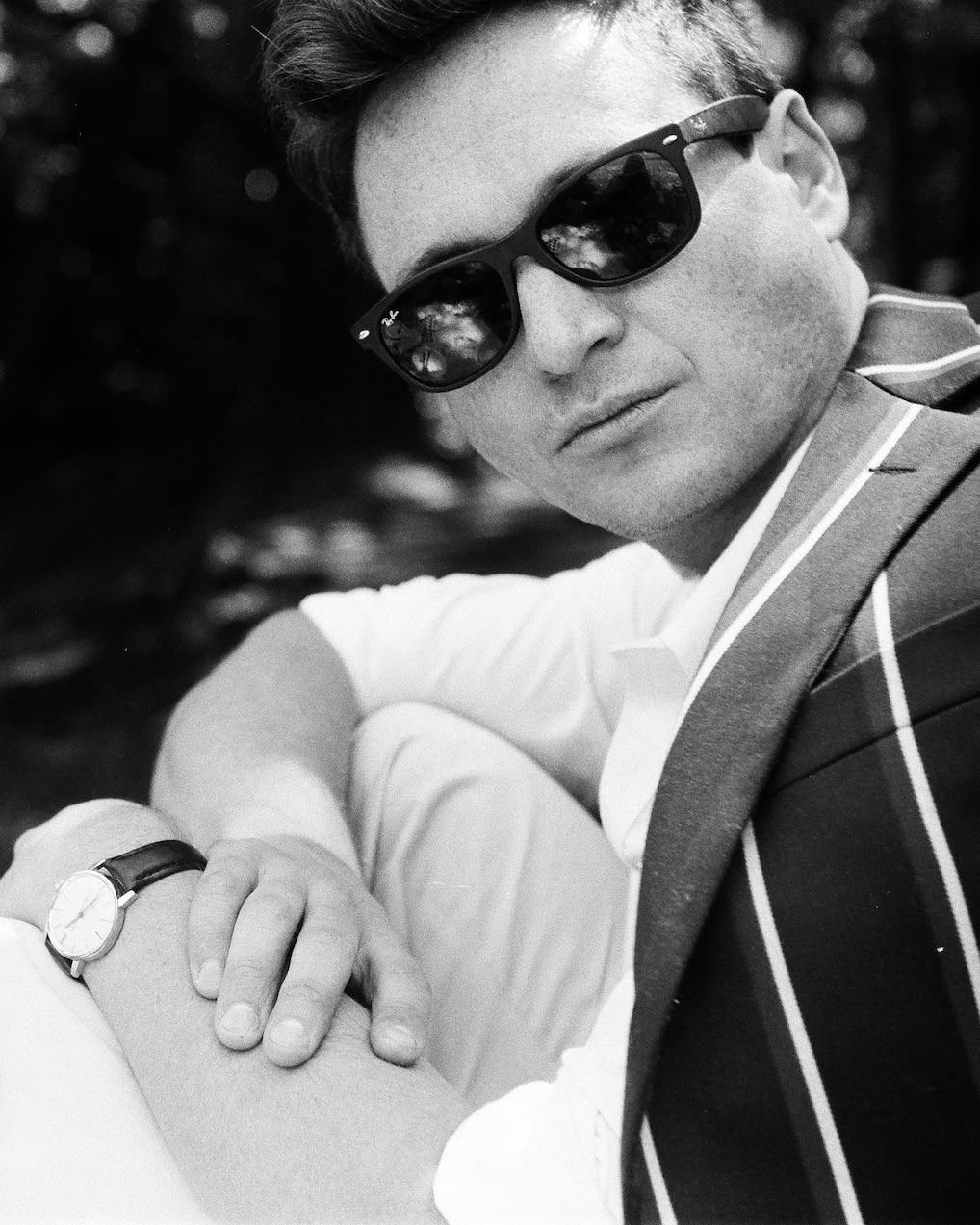 Hans Sprecher, shot in black and white on a Leica IIIf. Omega watch, Wayfarer shades, regatta jacket by Brooks Brothers.